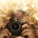 messy-hair-woman-camera
